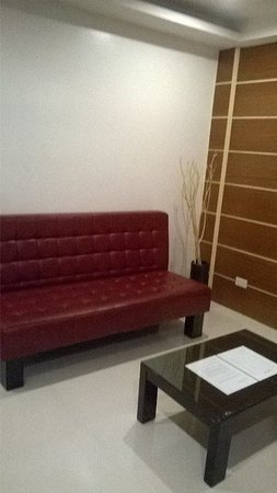 Sofa and TV room outside the bedroom - Picture of Guijo Suites ...