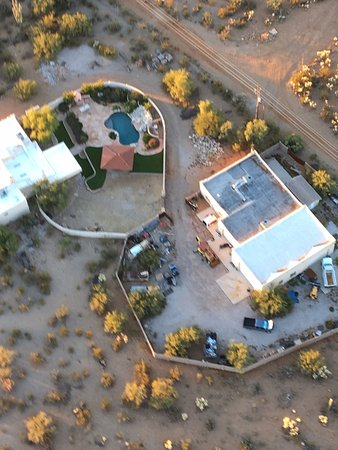 Tucson Balloon Rides: Passing over a home.