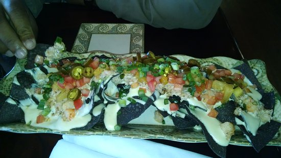 Key West Grill : Nacho Del Mar. It's good (if you tend to like seafood).Kind of pricey but you get alot.