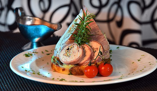 Ghajnsielem, Malta:  Chicken Roulade set on baked pressed potatoes served with berry Jus.