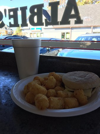 Kingston, RI: Breakfast sandwich and tater tots, with a coffee.