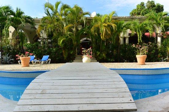 Petit Goave, Haiti: bridge over pool facing dining area