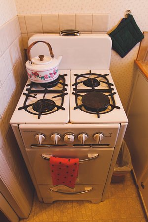 Sisters, OR: Unit #5 - Granny's Cozy Cottage: A close-up view of the antique stove in this charming Kitchenet