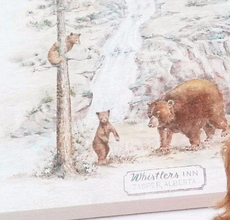 The Den - Jasper's Wildlife Museum: A painting of bears on the wall outside of the Whistler Inn.