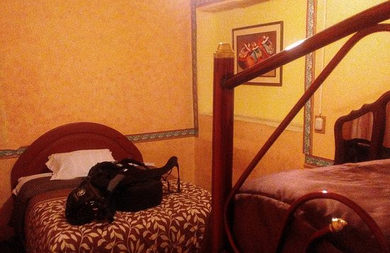 Hostal Villa Del Rosario: My room has a queen bed (shown) which I use to organize things...