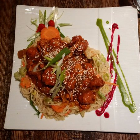 Campbellford, Canada : Sweet and sour chicken over a bed of perfectly cooked noodles - yum!