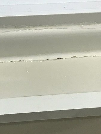 Coolum Beach, Australia: Mouldy skirting and shower, lifting laminates in bathroom, dirty tiles that need a good clean, d
