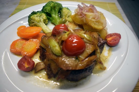 Bistro Boileau:  Fillet chef with green onion mushrooms, cherry tomatoes and sage! Fresh vegetables and saute po