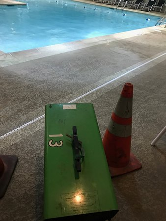 Itasca, IL: Pool area So unsafe.Frayed extension cord wrapped up with electrical tape.Emergency button froze