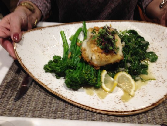 Plainville, MA : Baked Cod on broccoli rabe. Very good.