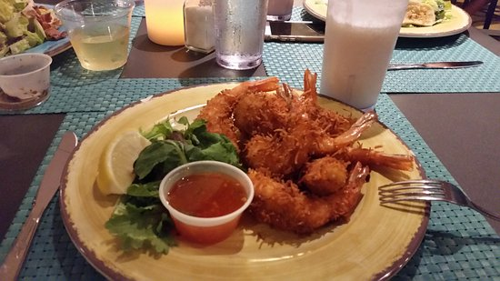Tradewinds: Coconut shrimp and coconut cocktail.  Excellent! and very friendly.