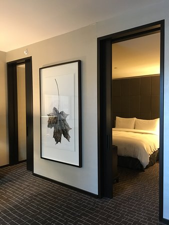 The Hazelton Hotel: view from the living room into the bedroom with sliding  doors