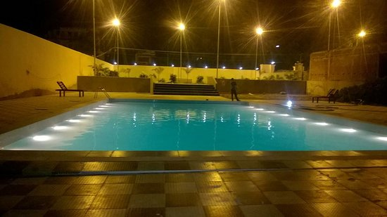 swimming pool Area with Loan - Picture of Hotel Nalanda Regency ...