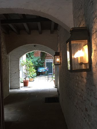 Historic New Orleans Tours : One of the many arched passages to hidden courtyards to be found in the Quarter