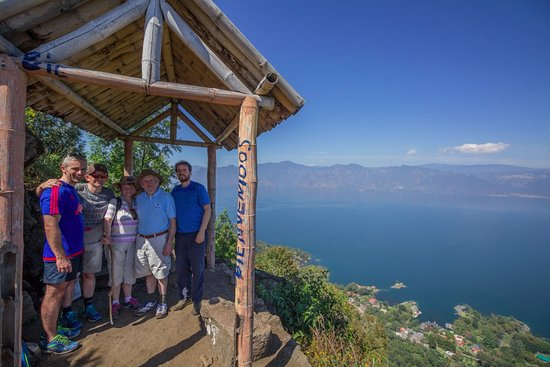 San Lucas Toliman, Guatemala: Organised hike to sacred hill Cerro de Oro with a view of Lake Atitlan in the background.