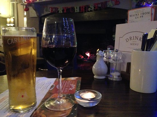 Beckington, UK: A relaxing drink in front of the open fire