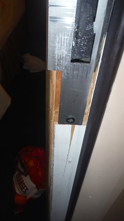 Lewis River Inn: The door frame is cracked, showing a previous break in.