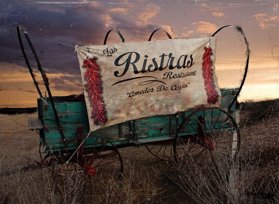 Corrales, Nuevo Mexico: this uncovered wagon is outside of the restaurant as their landmark
