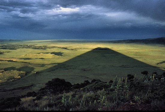Photo made in August of 1992 from Capulin summit .  Passing thunderstorm allowed for shadow of v
