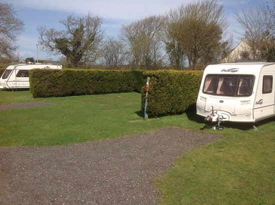 Stonebridge Farm Caravan Park: Adult only grass pitches with electric hook up, shared water tap and high privacy hedging.