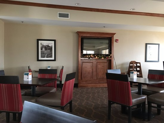 Comfort Suites Dining Area With Television