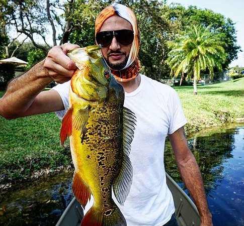 huge peacock bass caught in Miami canal with Capt Scott ...