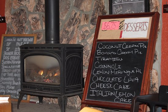 warm yourself up next to the fireplace picture of capos corner