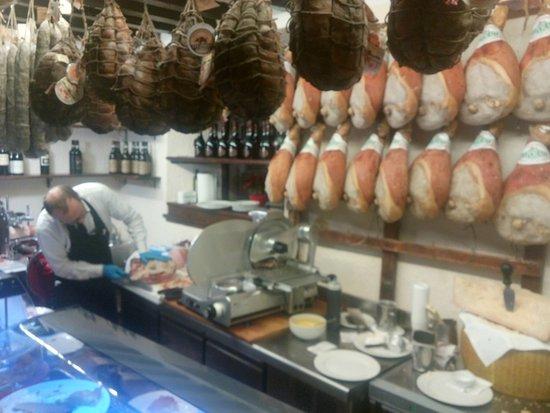 trattoria del tribunale nice exhibition of parma ham and culatello right at the entrance