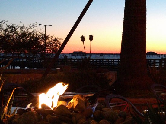 Open pit fireplace with view toward the ocean sunset - Picture of ...