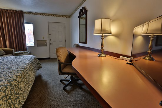 Nittany Budget Motel: Our King rooms provide a spacious work area, fold out couch, flat screen television, and mini-fr