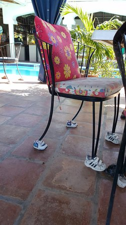 Bird Cage Restaurant : Chair legs need shoes too, right?