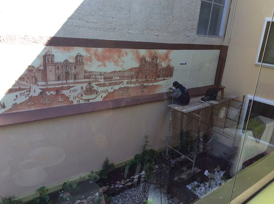 Hotel Torre Dorada: A mural of Cuzco's main square being painted in the hotel courtyard.