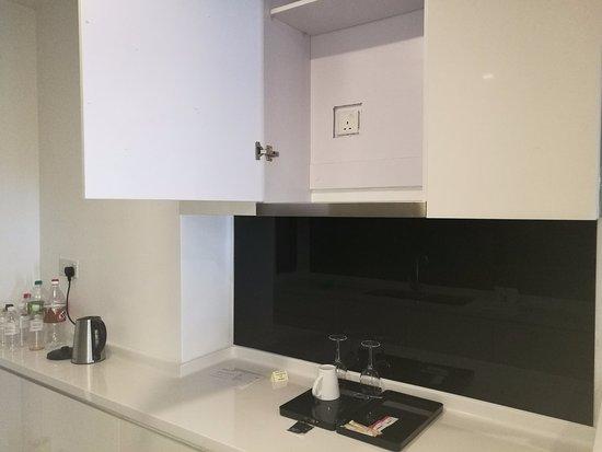 Poor workmanship hidden inside the kitchen cabinet Picture of
