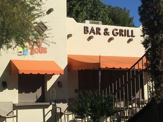 Litchfield Park, AZ: outdoor bar and grill near the pool and the Kids Zone area
