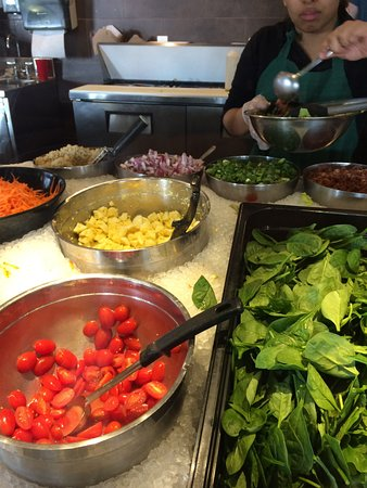 Irving, TX: Adding ingredients to the salad