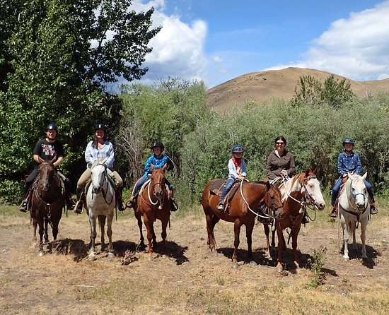 Wolf Creek, MT: On a trail ride with the ranch' Bald Mountain in the background