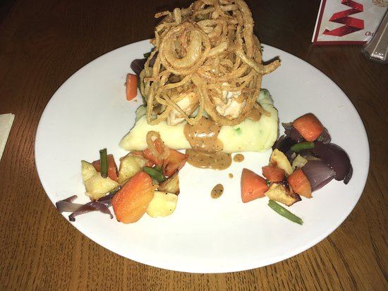 Dungannon, UK: Supreme of Chicken on a bed of Champ, with tobacco onions and seasonal veg and a peppered sauce
