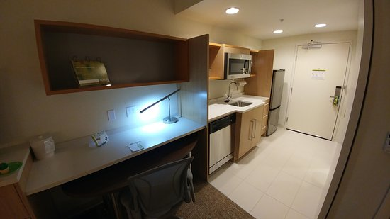 Home2 Suites By Hilton Destin Work Area And Kitchen