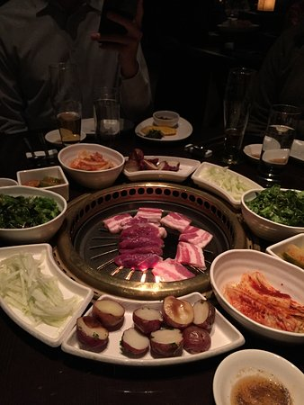 Korean Bbq Table With Grill In Center And Side Dishes Picture Of