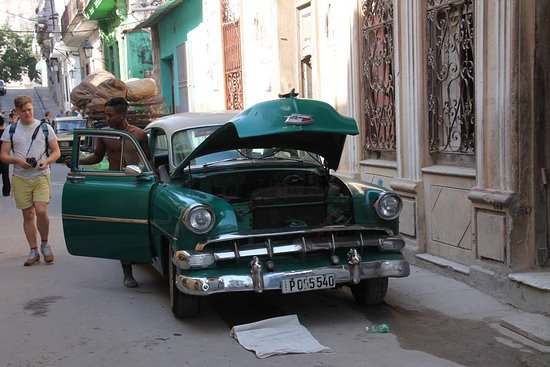 Central Havana: Vintage car being fixed