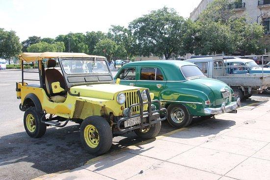 Central Havana: Vintage cars parked, including Jeep Willys