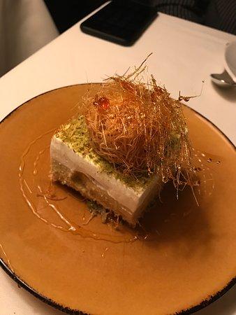 Kokkari Estiatorio: Unique dessert - with banana, whipped cream, coconut and carmelized sugar! FABULOUS!