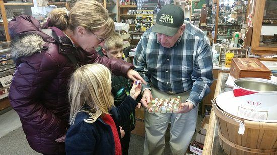York, NE: Lee gave each of the kids a few marbles and helped them select a shooter to buy.
