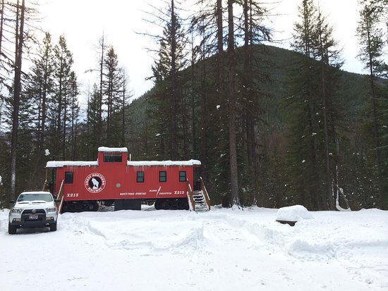 Essex, Montana: X215 caboose at the edge of a wooded drop off
