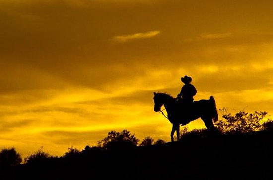 Wild West Sunset Horseback Ride with...