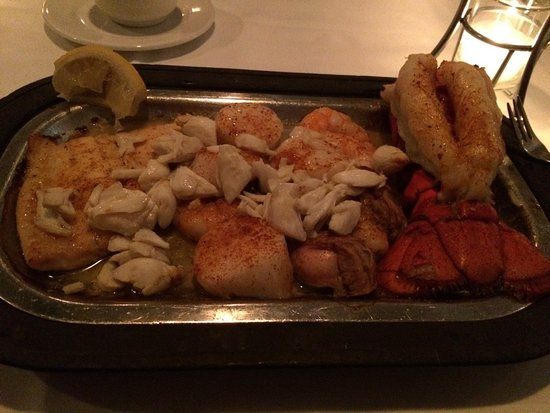 Seafare of Williamsburg: Mixed Seafood Grill - see lumps of crab meat on top of flounder, sea scallops, shrimp & oysters
