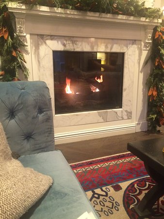 Fireplace in room with complementary tea/coffee/hot cocoa in the morning hour/wine hour in eveni