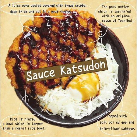 Sauce Katsudon  フルーティーな濃厚ソースのついたかつに温玉を絡めて食べてください!あっさりキャベツとほかほかご飯、ソースに温玉、サクサクかつをまとめて食べれば、最高のマッチング