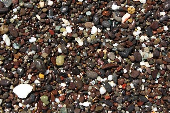 Herradura Beach: Pebbles on the beach look like jewels.