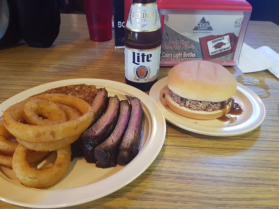 White Pig Inn Barbecue: Pork ribs, onion rings, chopped pork sand which and a beer- $13